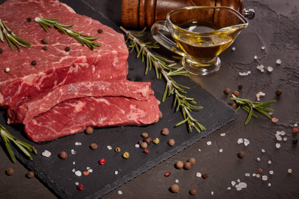Raw fillet beef with spices stock photo