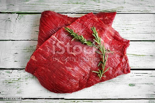 raw fillet of beef brisket on white wooden background