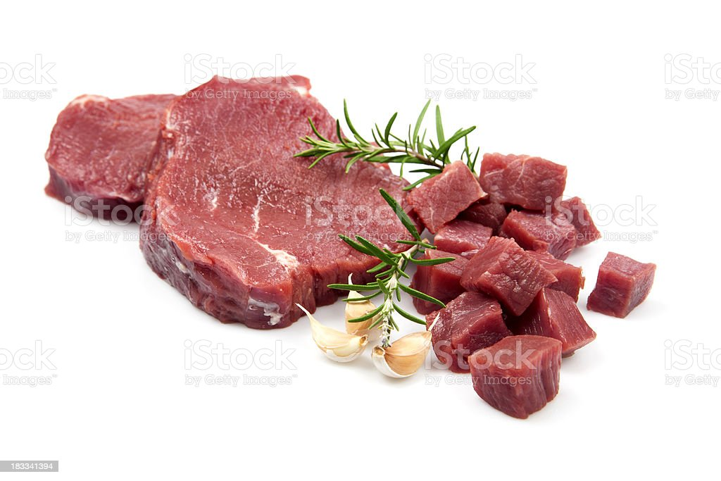Raw fillet steak and beef cubes royalty-free stock photo
