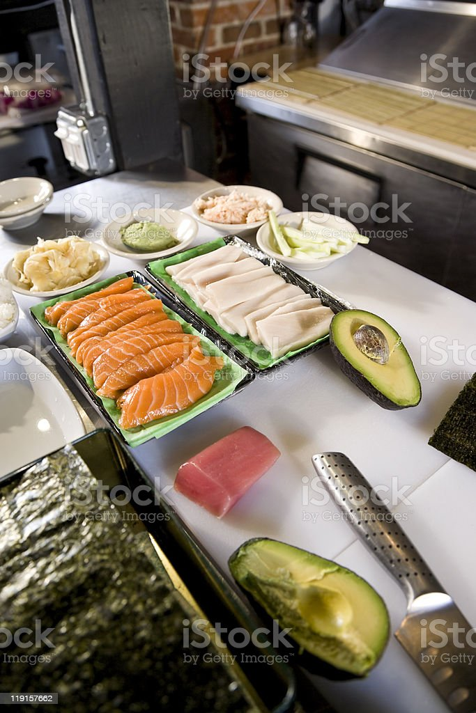 Raw fish and other ingredients for making sushi royalty-free stock photo