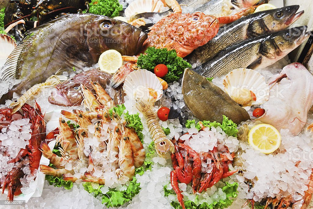 raw fish and seafood in ice stock photo