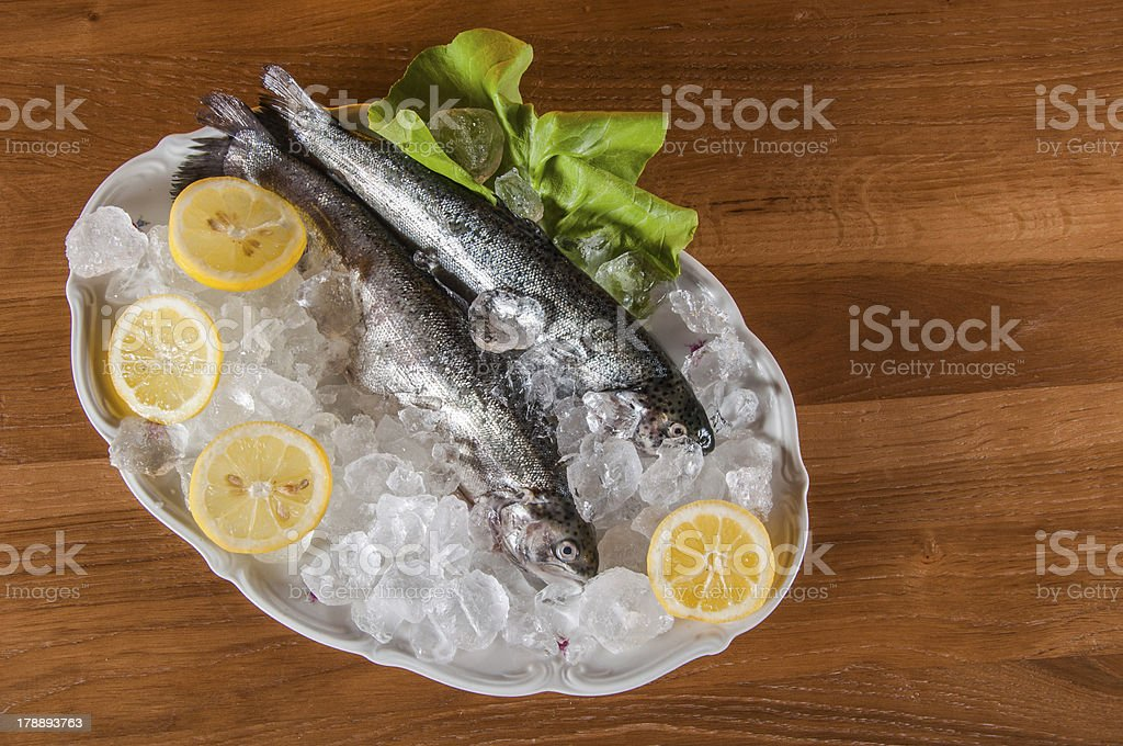 Raw fish on the plate and light background royalty-free stock photo