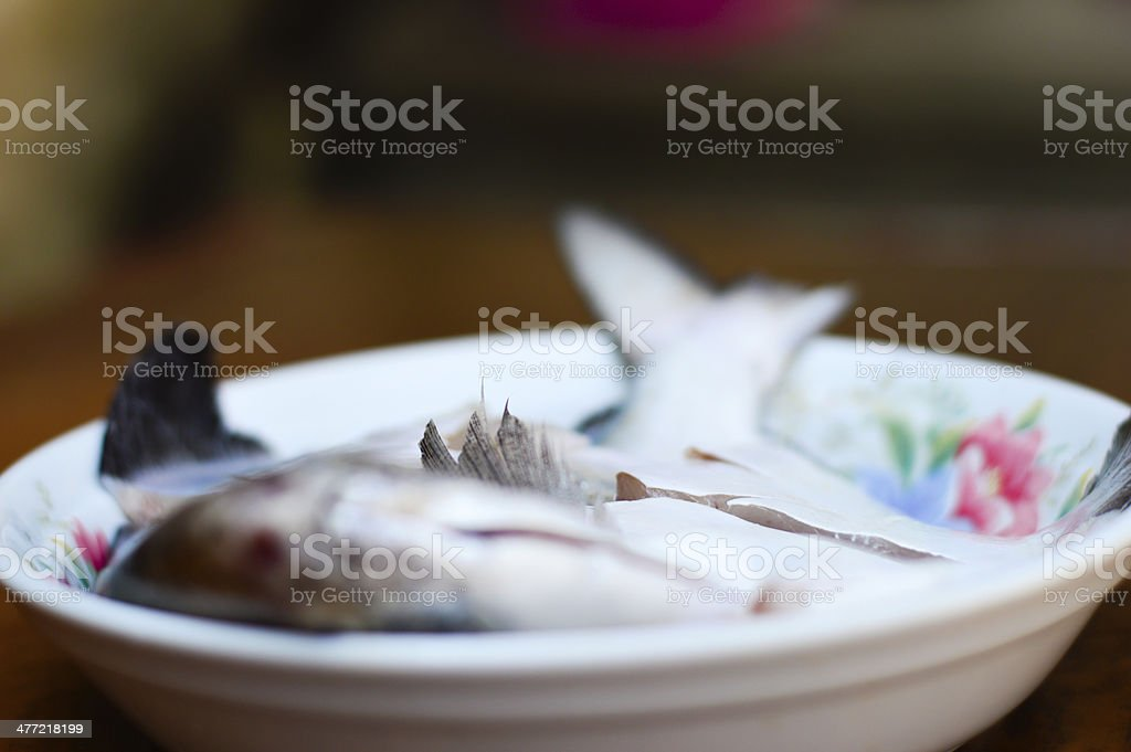 Raw fish on the plate royalty-free stock photo