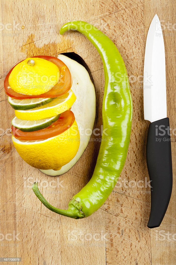 Raw food and ceramic knife royalty-free stock photo
