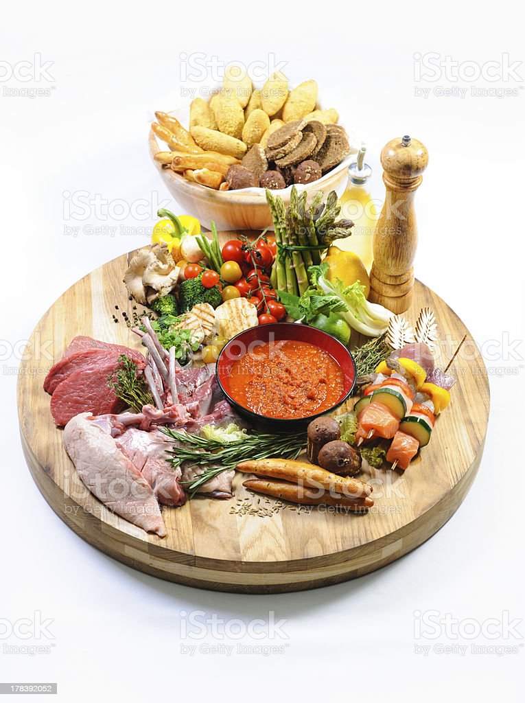 Raw food on a wooden board and bread royalty-free stock photo