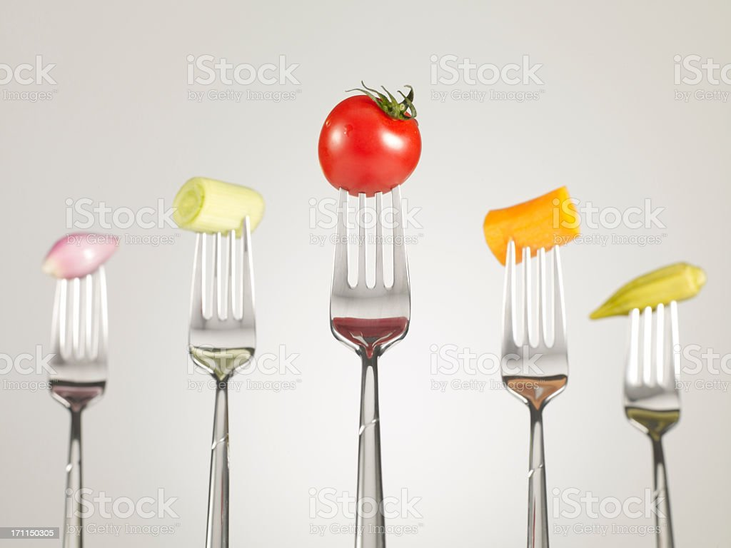 Raw Foods On Fork. royalty-free stock photo