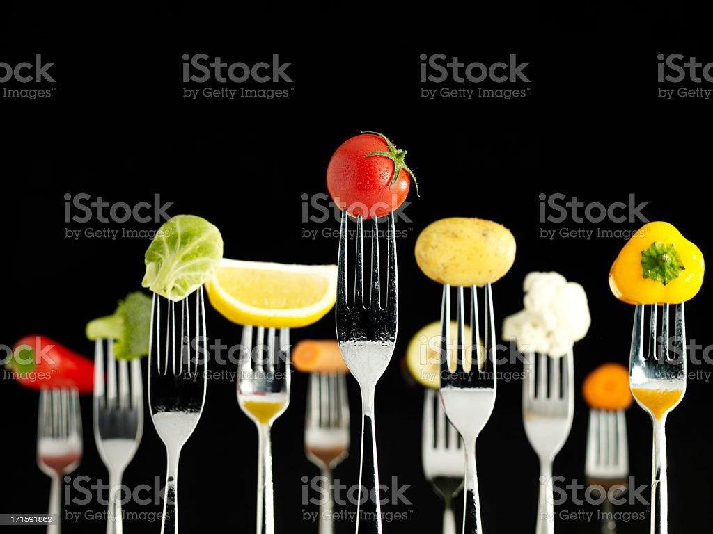 Raw Foods On Forks (Wet) stock photo