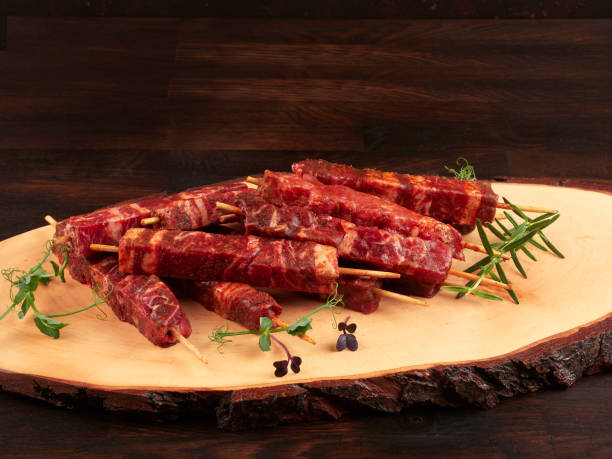 Raw fresh beef and lamb skewers, uncooked stock photo