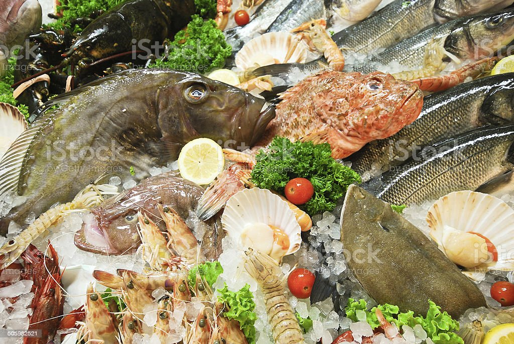 raw fresh fish and seafood on street market stock photo