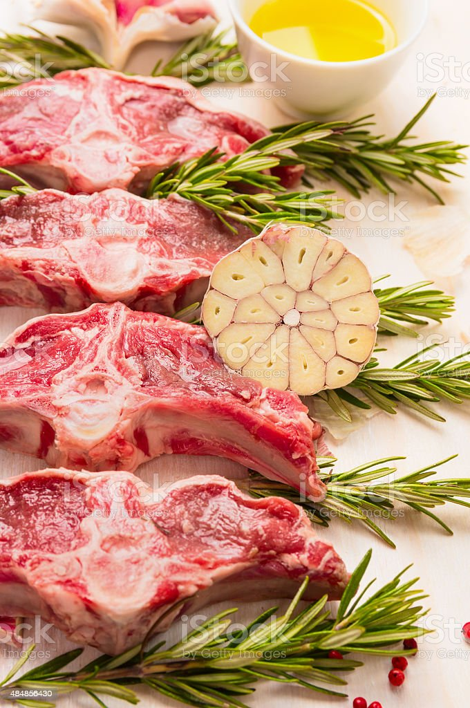 Raw fresh lamb loin chops with herbs and spices, preparation stock photo