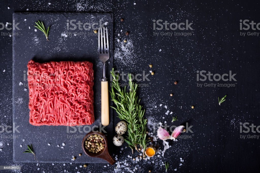 Raw fresh lamb meat, burger patty ingredients. Top view. stock photo