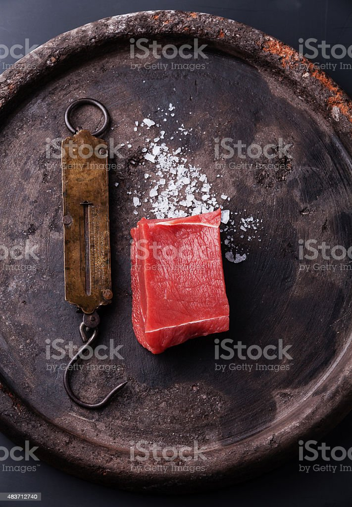 Raw fresh meat fillet and vintage steelyard stock photo