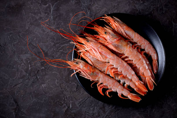 Raw fresh Prawn on black plate stock photo