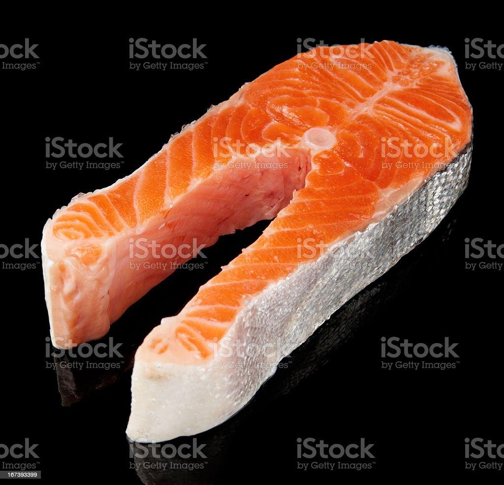 Raw fresh salmon steak isolated on black royalty-free stock photo