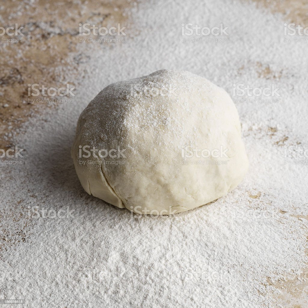 Raw fresh yeast dough isolated on white royalty-free stock photo