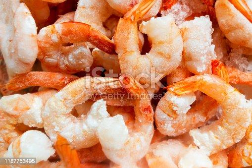 istock Raw frozen and peeled shrimp background. Pile of frozen shrimps  .Close-up of frozen shrimps. A lot of royal shrimp macro shot 1187753495