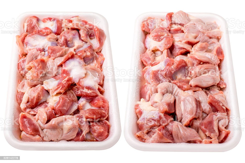 Raw frozen chicken gizzard in  plastic plate. Isolated on white stock photo
