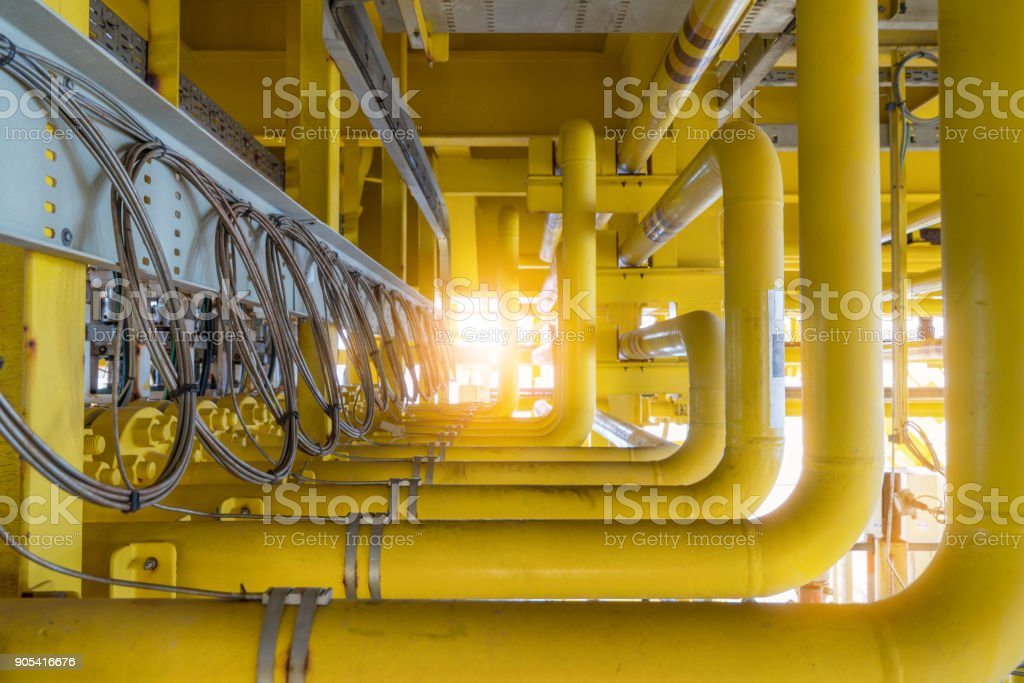 Raw gas flow line pipe with temperature sensor attached at surface of pipe to detect and sent data to transmitter and convert to reading temperature. stock photo