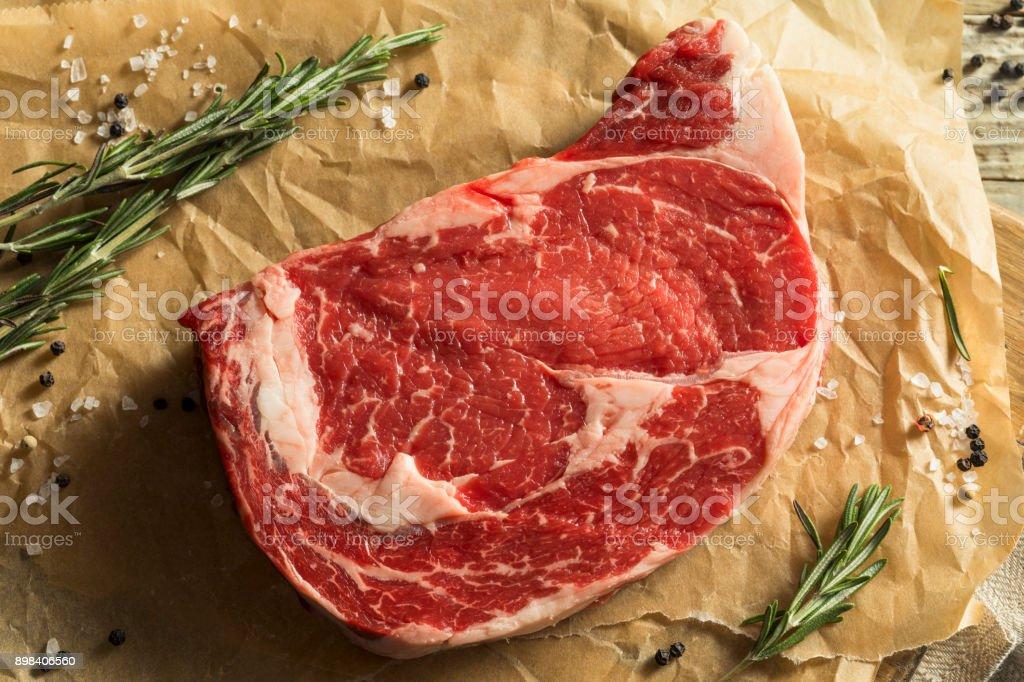 Raw Grass Fed Boneless Ribeye Steak stock photo
