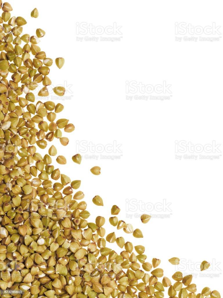 Raw green buckwheat isolated one edge royalty-free stock photo