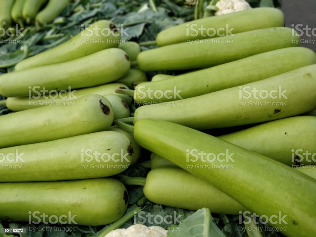 Raw green Calabash on display at Vegetable Stall stock photo