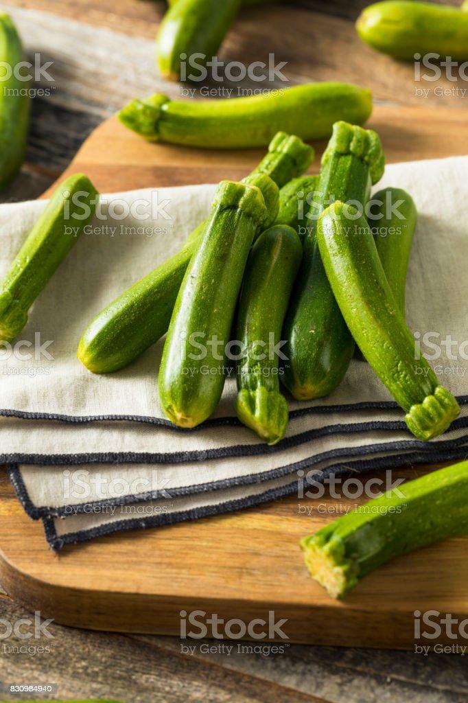 Raw Green Organic Baby Zucchini stock photo