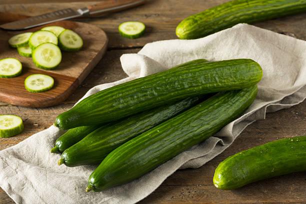 Raw Green Organic European Cucumbers stock photo