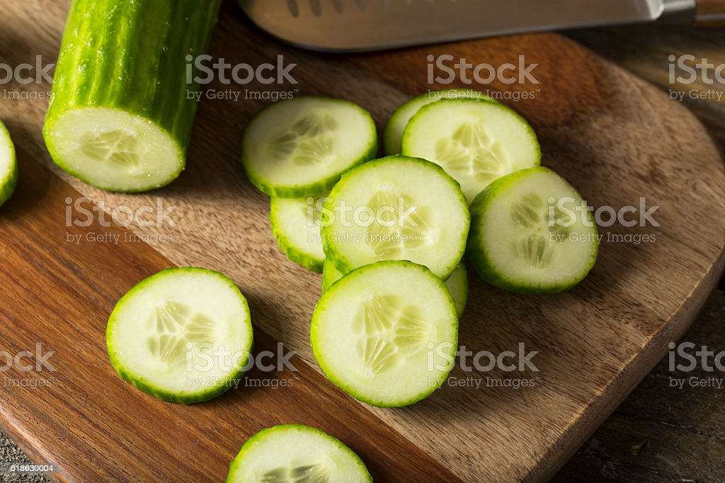 Raw Green Organic European Cucumbers stock photo