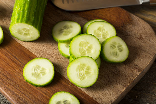 raw green organic european cucumbers - cucumber stock photos and pictures