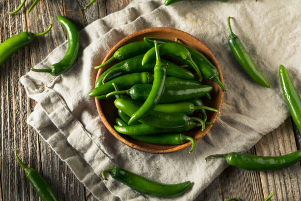 Raw Green Organic Serrano Peppers stock photo