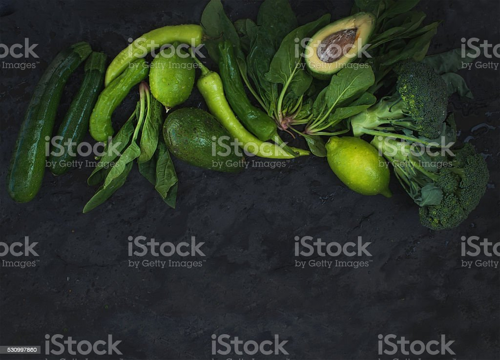 Raw green vegetables set. Broccoli, avocado, pepper, spinach, zuccini, lime stock photo