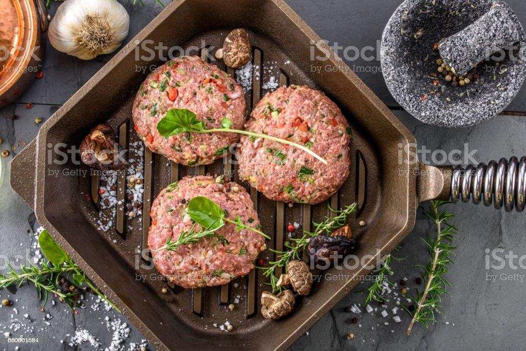 Raw Hamburger Patty stock photo