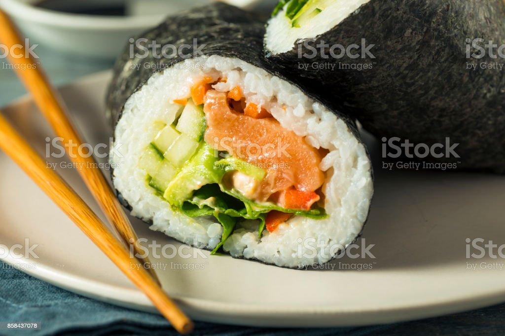 Raw Homemade Salmon Sushi Burrito stock photo