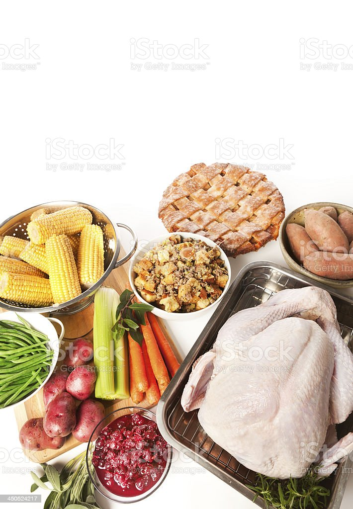 Raw Ingredients and Turkey for Thanksgiving Dinner Preparation Vertical royalty-free stock photo