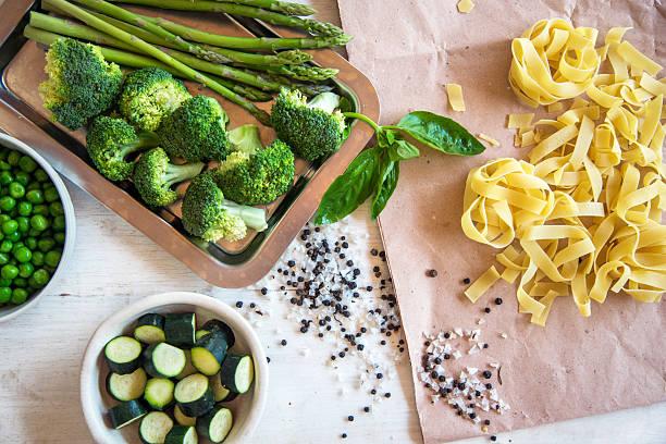raw ingredients for vegetarian pasta - spargel vegan stock-fotos und bilder