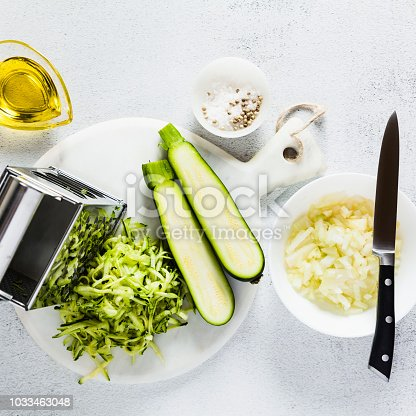 raw ingredients on the table. zucchini grate and finely chopped onions. healthy food.
