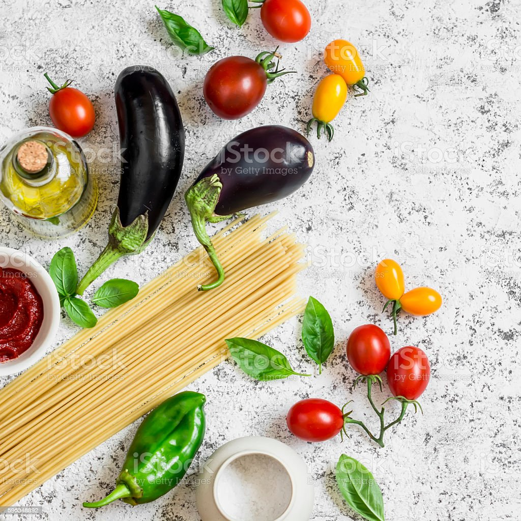 Raw ingredients - spaghetti, eggplant, tomatoes, pepper, olive oil royalty-free stock photo
