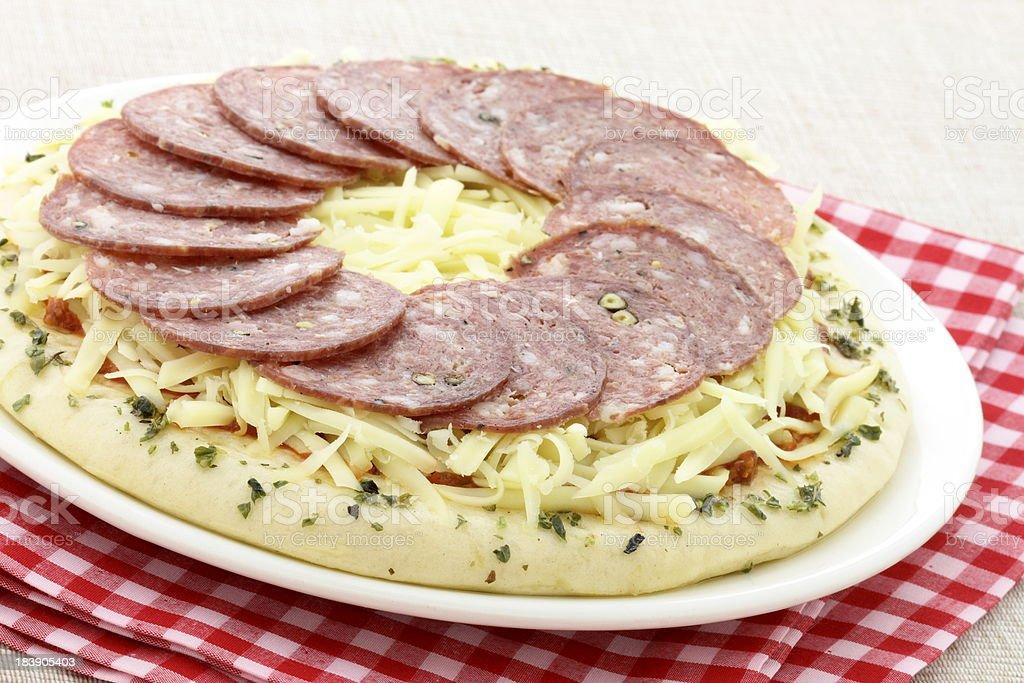 raw italian salami pizza royalty-free stock photo