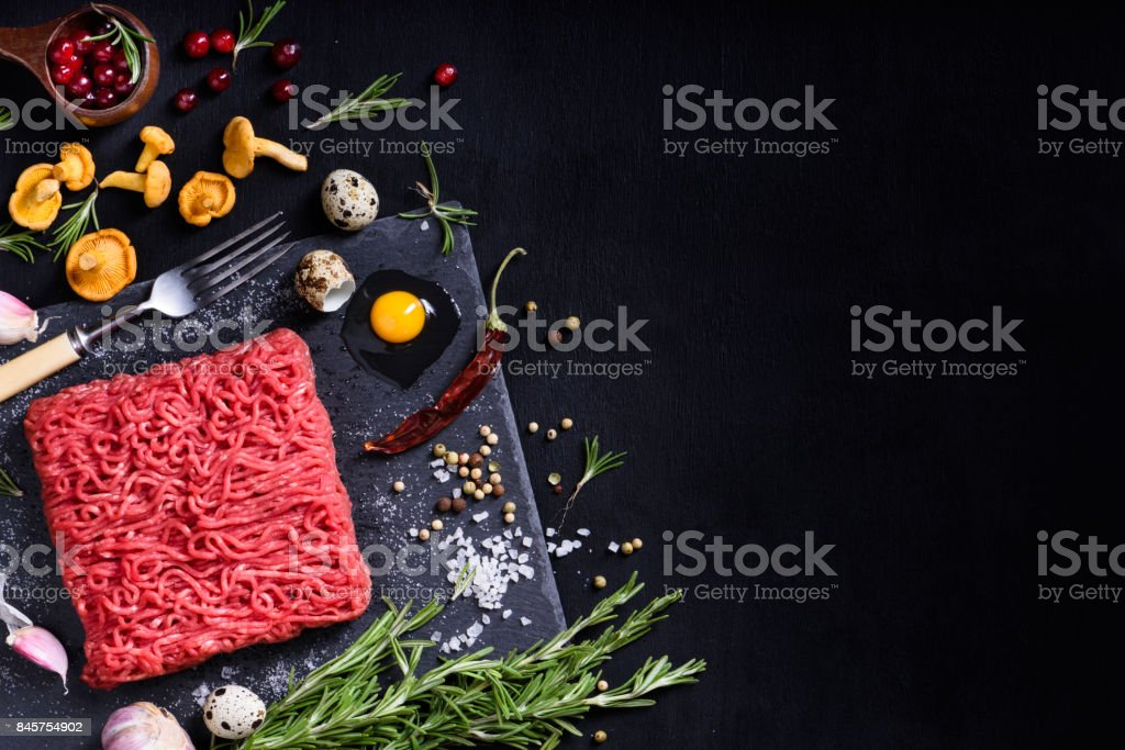 Raw juicy ground meat, ready for roasting. Above view. stock photo
