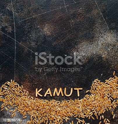 Raw Kamut grain with a word Kamut  top view