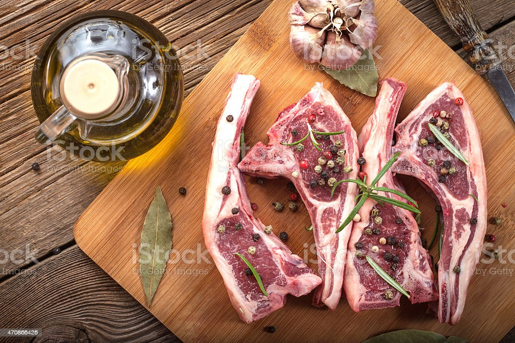 Raw lamb chop ready for frying. stock photo