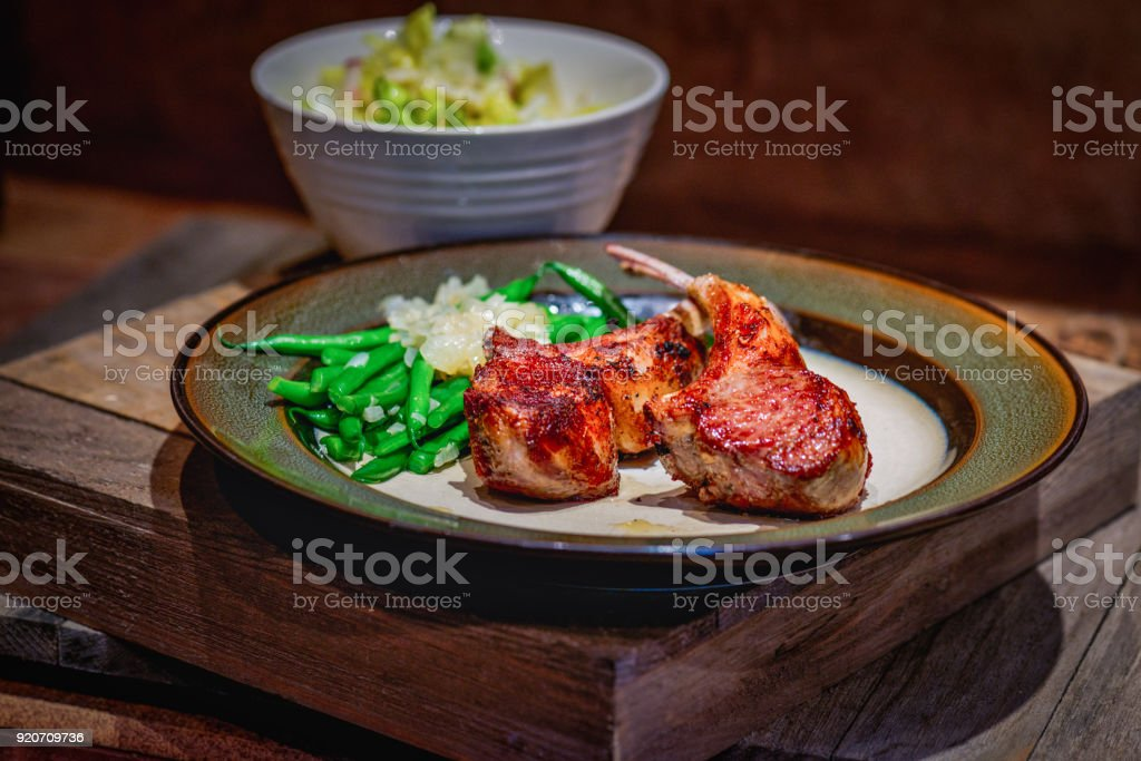 Raw lamb chops marinating stock photo