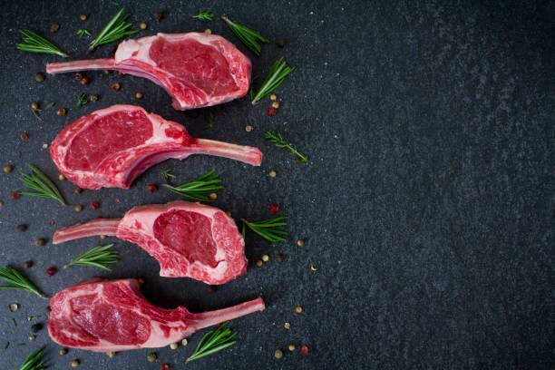 Raw Lamb Chops with seasonings stock photo