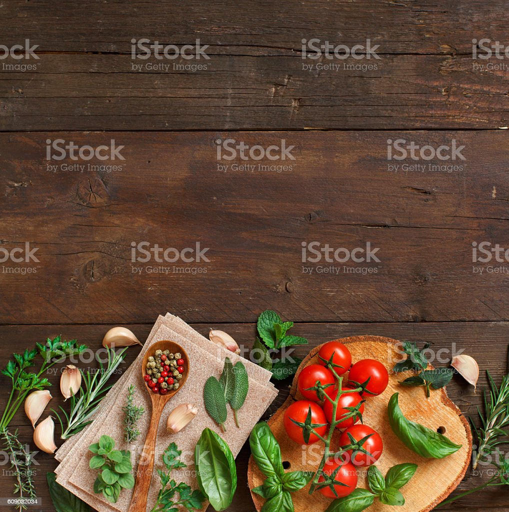 Raw lasagna pasta, vegetables and herbs stock photo