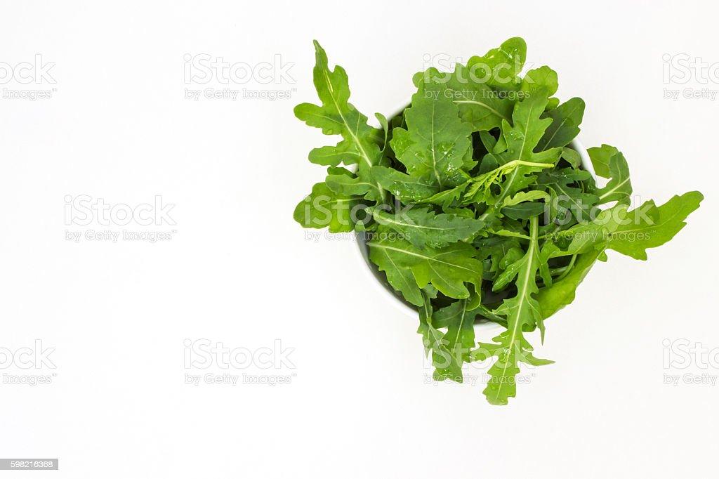 Raw lettuce arugula on a white table foto royalty-free