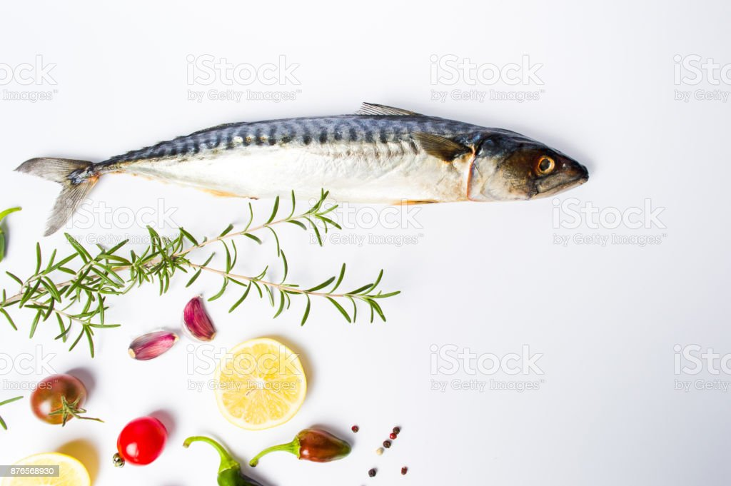 Raw mackerel fish with spices isolated on white stock photo