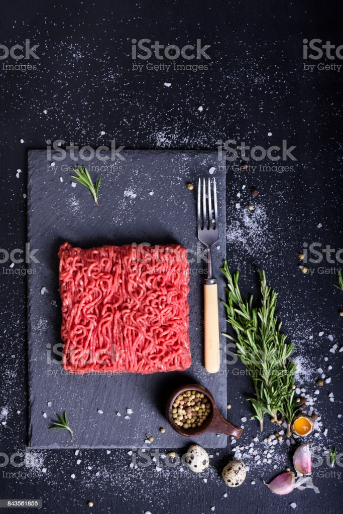 Raw marbled ground meat steak.Top view, copy space. stock photo
