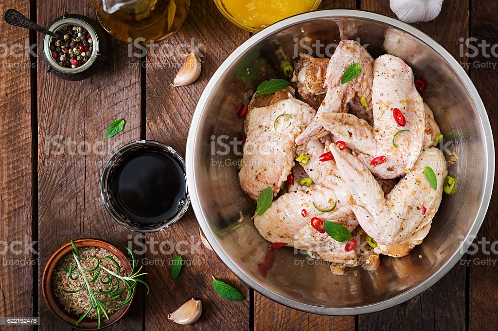 Raw marinated chicken wings prepared in Asian style stock photo