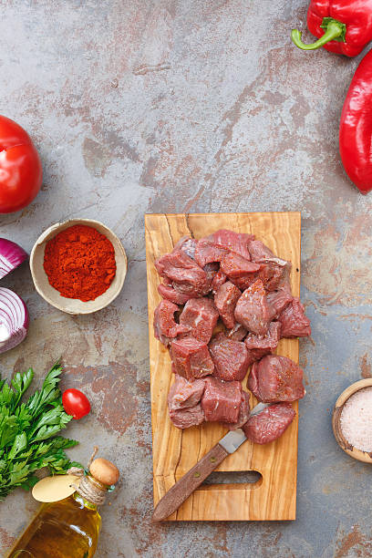 Raw meat and fresh ingredients for cooking stock photo