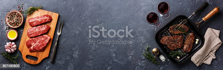 istock Raw meat and Grilled meat Top Blade steaks background copy space 807480800